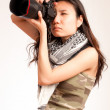 Asian serious photographer — Stock Photo