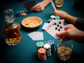 Gambling at the card table — Stock Photo