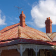 Stock Photo: Two chimneyed roof