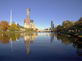 Sunny melbourne reflected in the yarra river — Stock Photo
