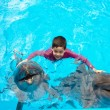 Child and dolphins - Stock Photo