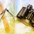 Binoculars, compasses and ruler over world map — Stock Photo
