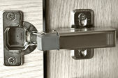 Furniture hinge in the door — Stock Photo