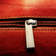 Leather bag and zipper background — Stock Photo