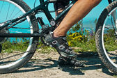 The rider's foot on a pedal bike — Foto Stock