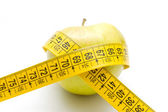 Apple and tape measurment — Stock Photo