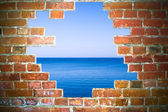 Red brick frame over sea landscape — Stock Photo