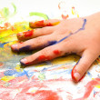 Painted child hand on colorful background — Stock Photo