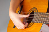Girl playing acoustic guitar — Stock Photo