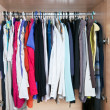 Wardrobe with clothes — Stock Photo