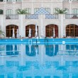 Stock Photo: Swimming pool at luxury inn