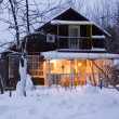 Cozy cottage in winter forest — Stok fotoğraf