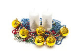Yellow spheres,tinsel and candles on white background — Photo