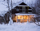 Cozy cottage in winter forest — Foto de Stock
