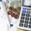 Business chart with calculator, pen and coins — Stock Photo