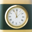 Clock shows five minutes to twelve — Stock Photo