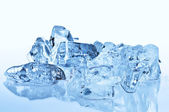 Blue ice cubes with reflection — Stock Photo