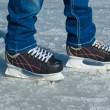 Feet in ice skating rink — Stock Photo #44076201