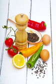 Fresh vegetables and eggs on wooden background — Stock Photo