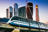Skyscrapers and monorail train — Stock Photo
