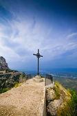 Cross on the cliff Montserrat mountain — Stock Photo