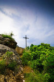 Silhouette image of the cross on the cliff Montserrat mountain — Stock Photo
