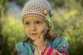 Girl in knitted cardigan — Stock Photo