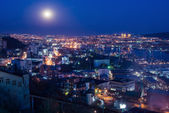 Full moon over the city — Stock Photo
