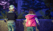 Children playing in the evening — Stock Photo