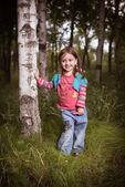 Girl in a birchwood — Stock Photo