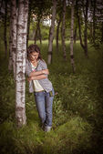 Young woman in a birchwood — Stock Photo