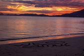 Sunset on a tropical beach — Stock Photo