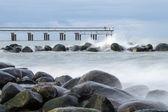 Rocks, sea and pier. — Stock Photo