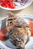 Baked tilapia served with red pepper sauce — Foto Stock