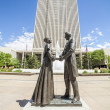 Joseph Smith with wife in front of LDS main office building — Stock Photo #51103971
