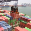 Container ship being loaded at the Port of Yantian, China - Stock Photo