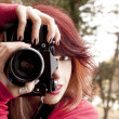 Retro girl photographer — Stock Photo