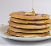 Stack of Pancakes with Butter and Honey — Stock Photo