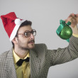 Nerd with gift — Stock Photo