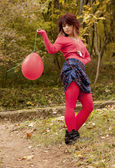 Autumn girl with red baloon — Stock Photo