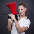 Business woman with red megaphone — Stock Photo