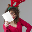 Girl holding blank christmas card — Stock Photo