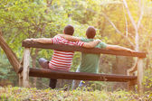 Gay couple in the park — Stockfoto