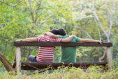 Gay couple in the park — Stock fotografie