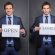 Businessman holding closed and open signs — Stok fotoğraf