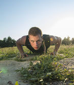 Handsome guy doing push-ups — Stock Photo