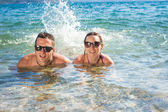 Smiling couple enjoying in water — Photo