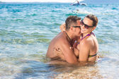 Smiling couple enjoying in water — Stock Photo
