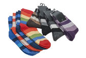 Several pairs of striped socks on a white background — Stock Photo