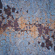 Stock Photo: Metal surface with old paint and rust spots.